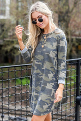 Model wearing the French Terry Camo Dress with polarized aviator sunglasses and trendy shoes from dress Up boutique