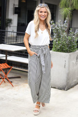 Model wearing the Tie Front Wide Leg Pants from Dress Up with basic white tee