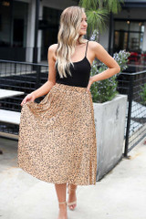 Model wearing the Spotted Pleated Midi Skirt in Tan front view
