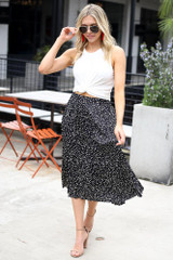 Model wearing the Spotted Pleated Midi Skirt with a white tank