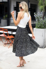 Model wearing the Spotted Pleated Midi Skirt in Black moving view