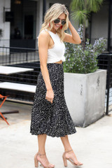 Model wearing the Spotted Pleated Midi Skirt in Black side view