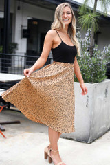 Model wearing the Spotted Pleated Midi Skirt in Tan Moving view