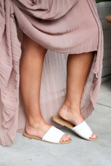 White - Dress Up model wearing the Faux Leather Slip On Sandals