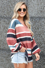 striped knit top paired with distressed denim shorts