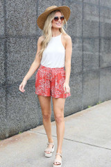 cute tropical shorts paired with white tank, sunhat, and sandals