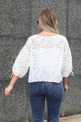 back view of eyelet lace tie sleeve top