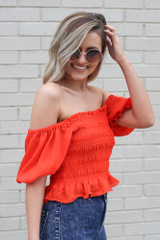 side view smocked puff sleeve top in red