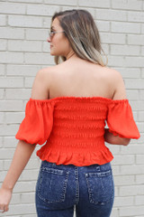 back view red smocked top