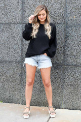 ribbed knit pullover styled with cheetah platform espadrilles and distressed denim shorts
