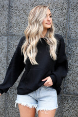 Black - oversized ribbed knit pullover with front pocket