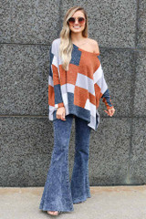 color block top paired with flare jeans