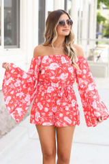 Model wearing the Floral Bell Sleeve Romper in Coral Side View