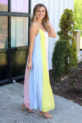 Model of Dress Up wearing the color block maxi dresses with cute sunglasses and trendy shoes from Dress Up Boutique