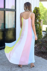 Model wearing the Multi-Colored Striped Maxi Dress in Yellow with cute sandals from Dress Up Boutique