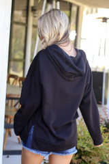 Model wearing the Fleece Lined Hoodie in Black with high rise shorts from Dress Up