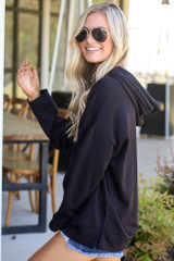 Model wearing the Fleece Lined Hoodie in Black with denim shorts from Dress Up