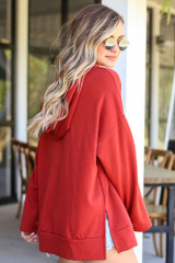 Model wearing the Fleece Lined Hoodie in Red with high rise jeans from Dress Up Side View