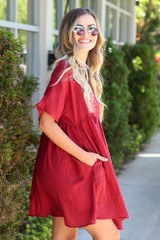 Side view of the Textured Babydoll Dress in Burgundy