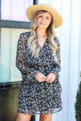 Model wearing the Floral Tiered Dress with a wide brim hat