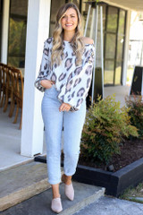 Model wearing the Button Shoulder Leopard Top with distressed jeans and heeled mules