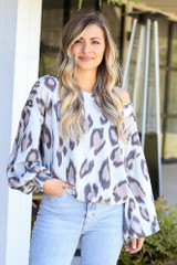 Model of DressUp wearing the Button Shoulder Leopard Top with high rise distressed denim jeans