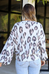 Model wearing the Button Shoulder Leopard Top from Dress Up Boutique Back View