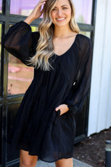 Model wearing Black Tie Back Pleated Babydoll Dress full outfit view