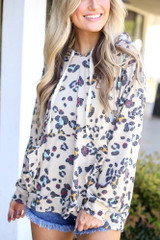 Taupe - Dress Up model wearing the Leopard Ruffle Trim Hoodie
