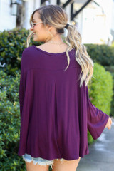 Model from Dress Up wearing the Jersey Knit Bell Sleeve Top in Purple Back View