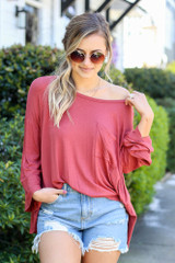 Model from Dress Up wearing the Jersey Knit Bell Sleeve Top in Rust