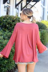 Model from Dress Up wearing the Jersey Knit Bell Sleeve Top in Rust Back View