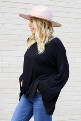 Model from Dress Up wearing the Jersey Knit Bell Sleeve Top in Black Side View