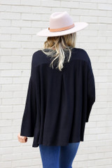 Model from Dress Up wearing the Jersey Knit Bell Sleeve Top in Black Back View