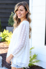 flowy white blouse at dress up boutique