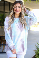 pink oversized tie-dye pullover with biker shorts