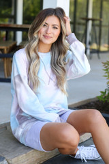 oversized tie-dye pullover with biker shorts and converse