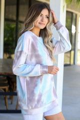 cute tie-dye pullover styled with biker shorts