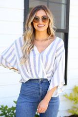 cute striped surplice blouse with flare jeans at dress up