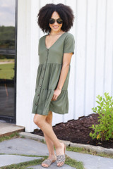 Model wearing the Tiered Babydoll Dress in Olive