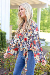 cute floral wrap blouse at dress up boutique