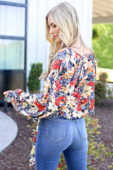 back view floral blouse with flare jeans at dress up