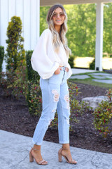 side view light was distressed denim jeans