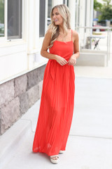 Red - Dress Up model wearing the Front Tie Pleated Maxi Dress with sunglasses