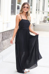 Model wearing the Front Tie Pleated Maxi Dress in Black with nude heels