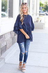tiered sleeve babydoll top paired with distressed denim jeans