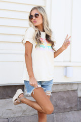 cute graphic t-shirt with distressed denim shorts and platform espadrilles