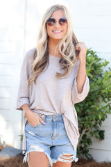 Blush - oversized soft knit tee styled with cute sunglasses and distressed denim jeans
