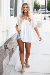 Model wearing the ruffle sleeve babydoll top in white