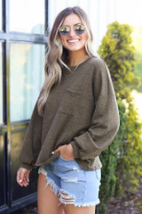 Olive - side view top with distressed denim shorts